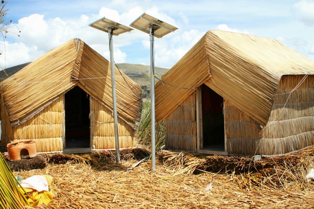 Reed huts. The solar panels are only a couple of months old and means they aren't using candles in their highly flammable homes