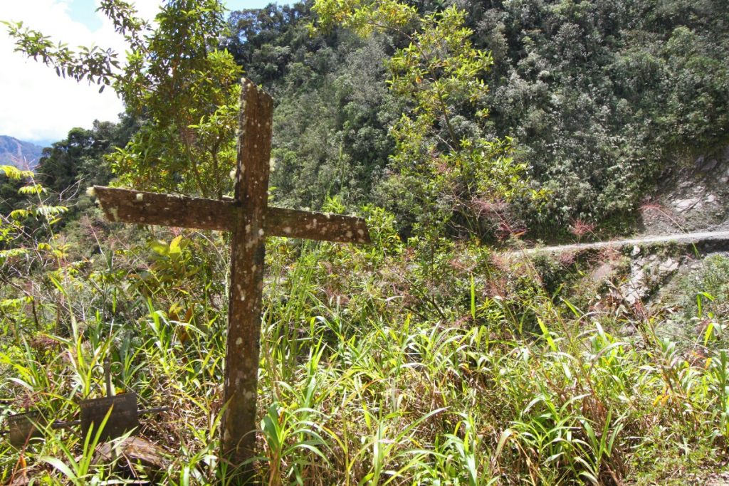 The road is scattered with crosses